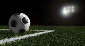 Soccer ball on the field of stadium Stock Photography