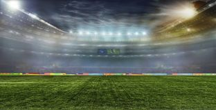 Soccer ball on the field of stadium Royalty Free Stock Images