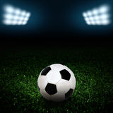 Soccer ball on the field of stadium with light Royalty Free Stock Photo