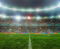 Soccer ball. On the field of stadium with light Royalty Free Stock Photos