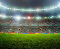 Soccer ball. On the field of stadium with light Stock Photography
