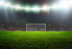 Soccer ball. On the field of stadium with light Stock Images