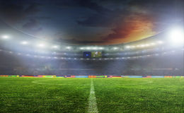 Soccer ball on the field of stadium royalty free stock photo