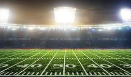 Soccer ball on the field of stadium Stock Image