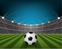 Soccer ball on the field of stadium with light Stock Photography