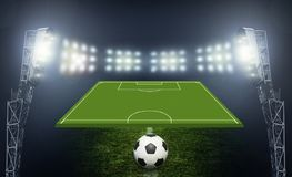 Soccer ball on the field of stadium Stock Images
