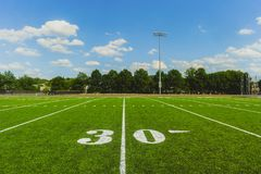 Soccer ball on the field of stadium royalty free stock photos