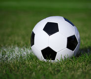 Soccer ball on the field with yard line. Football on grass Royalty Free Stock Photography