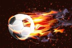 Soccer Ball On Fire. On dark background Stock Photos