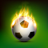 Soccer ball on fire. Fire soccer ball burning with green background Royalty Free Stock Image