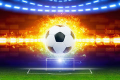 Soccer ball in fire. Abstract soccer background - burning soccer ball, soccer ball in fire, soccer goal on green field, world sports event Royalty Free Stock Photo