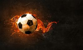 Soccer Ball on Fire. Concept of soccer game with ball in fire flames. Mixed media stock photography