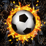 Soccer ball in fire flames Royalty Free Stock Image