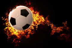 Soccer ball with fire and flames. Flying soccer ball with fire and flames Royalty Free Stock Photo