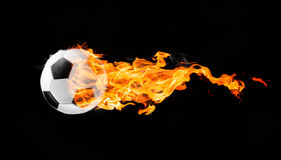 Soccer ball on fire. Flying football or soccer ball on fire. Isolated on black background Stock Photo