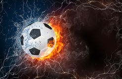 Soccer ball in fire and water. Soccer ball on fire and water with lightening around on black background. Horizontal layout with text space Royalty Free Stock Images