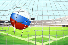 A soccer ball with flag of Russia hitting a goal Stock Image
