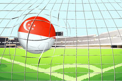 A soccer ball with flag of Singapore hitting goal Royalty Free Stock Image