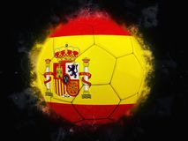 Soccer ball - Flag of Spain. Isolated on black background Royalty Free Stock Image