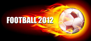 Soccer ball in flames. On a dark background Stock Photos