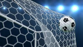 Soccer ball flies beautifully into the goal in slow motion. Soccer ball flies into the goal bending the grid on, ball