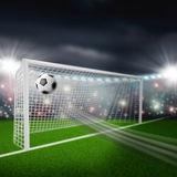 Soccer ball flies into goal Royalty Free Stock Photos