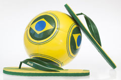 Soccer ball and flip flops with Brazil flag Royalty Free Stock Photo
