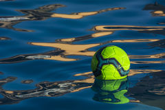 Soccer Ball. A soccer ball floating in swimming pool stock photos