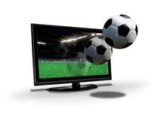 Soccer ball flying out from LCD screen. Over white royalty free stock photography