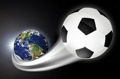 Soccer Ball Flying Out From Planet Earth. Concept of soccer ball streaking across the earth into space. With 250 million players in over 200 countries, soccer is royalty free stock photo