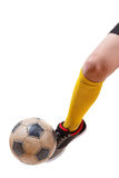 Soccer ball on the foot of a football player. Isolated white Royalty Free Stock Photos