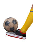 Soccer ball on the foot of a football player. Isolated white Royalty Free Stock Photography