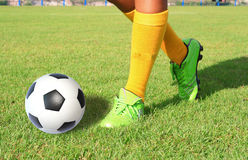 Soccer ball with foot of player kicking Royalty Free Stock Images