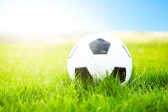 Soccer ball or football ball on green field Royalty Free Stock Images
