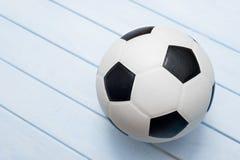 Soccer ball or football on blue wooden floor.  stock images