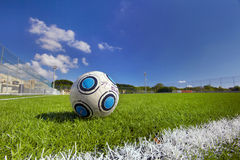 Soccer Ball on football field. With a nice blue sky Royalty Free Stock Photo