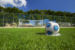 Soccer Ball on football field. With a nice blue sky Stock Images