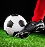 Soccer ball on the football field Stock Photo