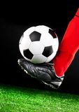 Soccer ball on the football field Stock Image