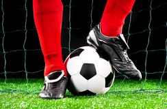 Soccer ball on the football field stock photography