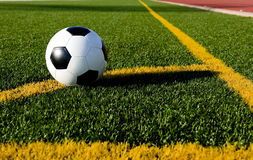 Soccer ball and football on a field Stock Image