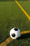 Soccer ball and football on a field Royalty Free Stock Images
