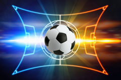 Soccer ball, football field layout, bright blue and red lights Stock Photography