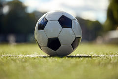Soccer ball on football field Royalty Free Stock Photos