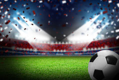 Soccer ball on football field in stadium with light. For design work Stock Photography