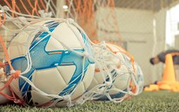 Soccer ball in football goal in soccer training ground Royalty Free Stock Photo
