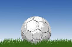 Soccer ball/football on grass royalty free stock photo
