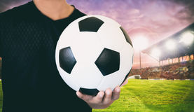 Soccer ball and Football on grass at football stadium in the sun. Set Royalty Free Stock Image