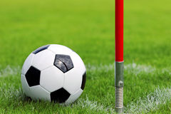 Soccer ball on football green field on the corner Royalty Free Stock Photos