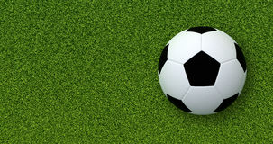 Soccer ball (Football) on green grass. Plenty of copy space. Top view. High quality 3d Render Royalty Free Stock Photos